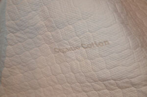 Extra firm crib mat with organic protector