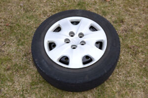 Four Rims with Covers and Michelin 205 60 R16 Primacy Tires