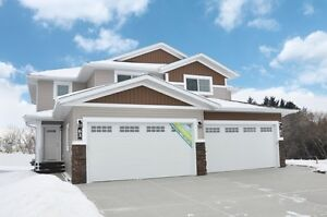 Brand New With Finished Attached Garage In Lacombe!