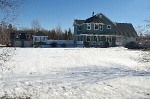 56 acres with house with detached garage and pool!