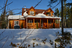 71 Riverview Drive in Fortune Bridge Water Front Log Cabin PEI