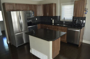 Beautiful Duplex located in Tamarack - With finished basement!