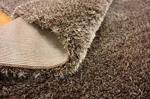 Uniqueloom Luxe Solid Shag Brown Area Rug 9x12 retails for $998