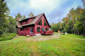 TRUE NORTH LOG HOME ON 74 ACRES