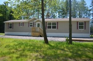 3 bedroom mini home on private lot for rent ($975+utilities)