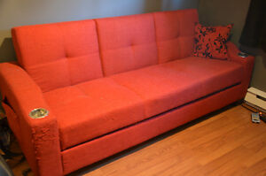 Red pull-out couch with storage