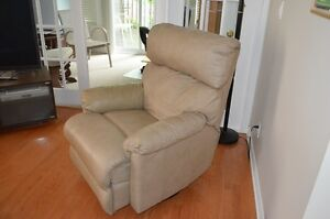 Leather, swivel rocker recliner.