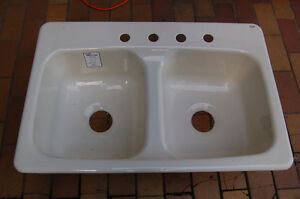 New off-white double bowl Eljer sink.