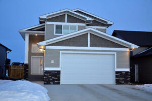 Main Level Suite w/ Over sized Garage, Master Ensuite & Upgrades