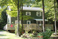 Beautiful home offering lots of privacy and country charm!