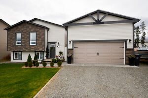 Copper Ridge-- 4 bedroom home with a 2 bedroom LEGAL SUITE