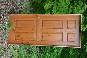 2 solid pine doors in frames with hardware.