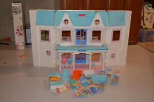 Miniature dollhouse with accessories and figures