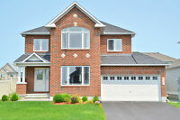 Spectacular 4 bedroom home with MANY upgrades,on a premium lot.