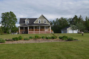 Completely renovated century home with water view