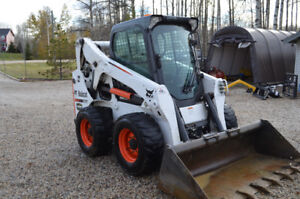Low Hour Bobcat S650 Skid Steer With Trailer and Attachments