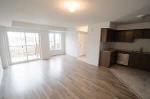 New condo townhouse for rent at Dundas and Sixth Line ground flr