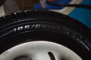 185/65R14 tire and rim ... Tire wear is that of new tire ....