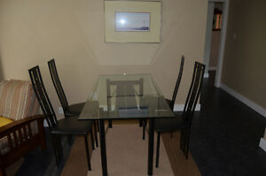 Glass kitchen table with 4 chairs