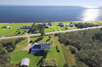 Ocean view & waterfront property at a great price !