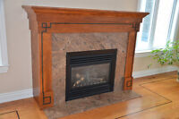 Large mantel (oak/granite) with gas fireplace insert