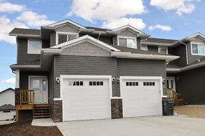 Beautiful New End Unit With Attached Garage In Sylvan Lake!