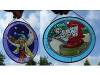 Two delightful hand painted glass Suncatchers