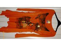 Next asymmetrical orange patterned top