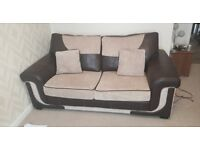 brown and cream sofa