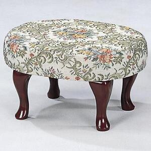 Small Upholstered in Floral fabric Foot Stool with Cherry Legs for Pedicure