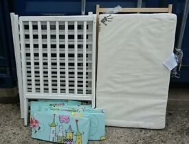 White space saver cot with mattress from Kiddicare