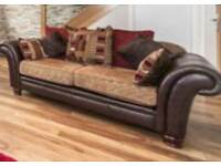 Two lovely sofas leather base and fabric cushions in great condition