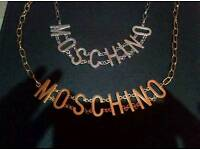 Moshino necklace x 2 one gold colour one silver