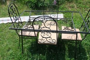 Four wrought iron upholstered chairs