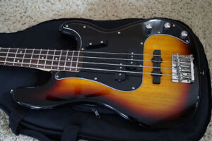 New Squier Vintage Modified Precision Bass with gigbag.