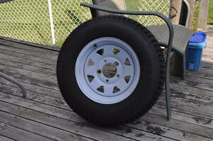 Utility trailer tire assembly