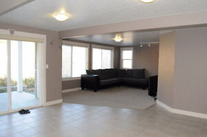 Bright level entry basement suite for rent in Bachelor Heights