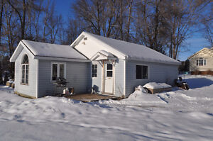 Snowmobile or Ice Fish in  White Lake then get cozy in a Cottage