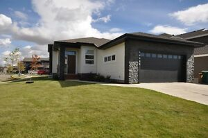 Enjoy modern elegance in this 1742sq.ft. custom built Bungalow.