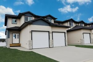 New Unit With Finished Attached Garage In Penhold!