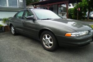 1998 Olds Intrigue with low kms. Good condition.