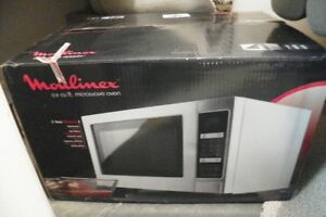 Moulinex stainless steel 0.9 cu. ft. microwave, new in box