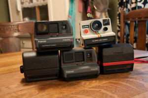 Various Polaroid instant cameras (see description for prices)