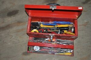 Toolbox with an assortment of tools