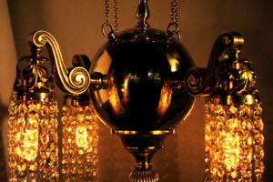 Dramatic Brass-orbed Chandelier Dripping with Swarovski Crystals