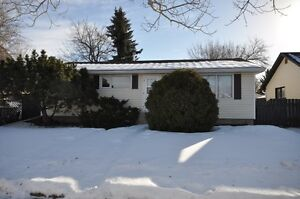 Bungalow on a large 50'x120' lot offering a great backyard