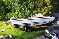 Peterborough Boat with Trailer and Motor, needs work