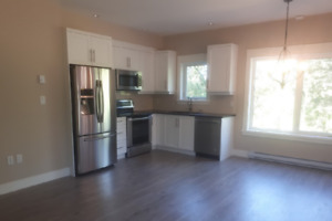 New 2 bedroom, 2 bath suite on private, quiet treed lot