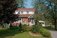 Well-loved home. Extra large landscaped lot in Carlington!