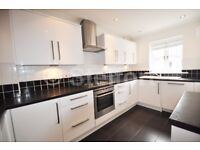 Bright and refurbished to high spec this 4 bedroom town house is set within gated development just m